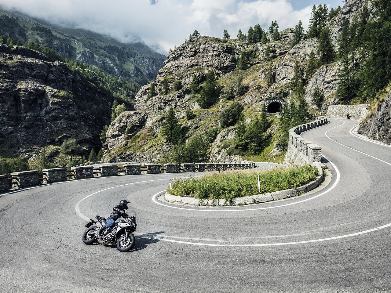 Yamaha Tracer 900 motorcycle riding on the hill road