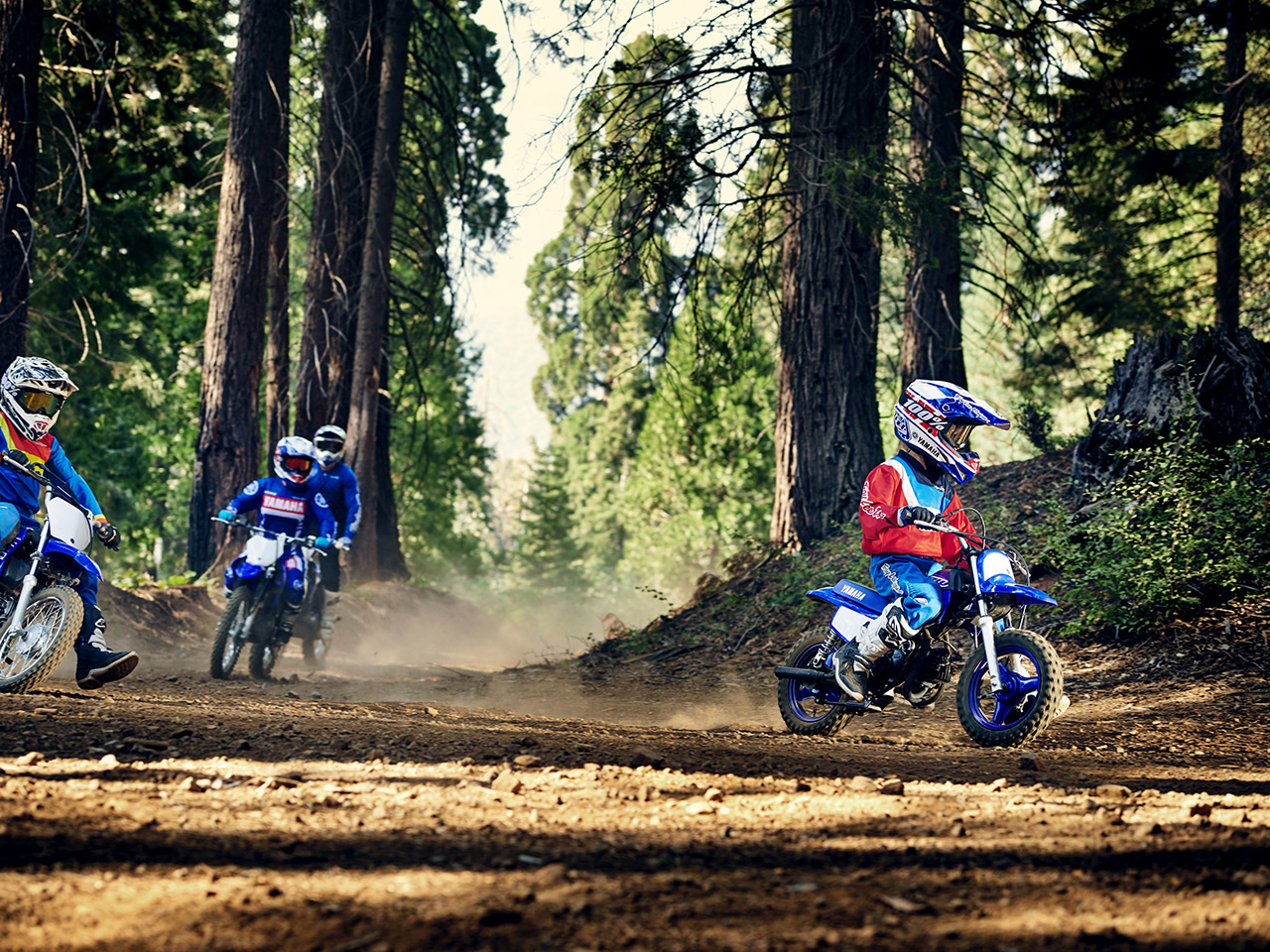 Yamaha PW50 in Team Yamah Blue And white colour, being ridden off-track