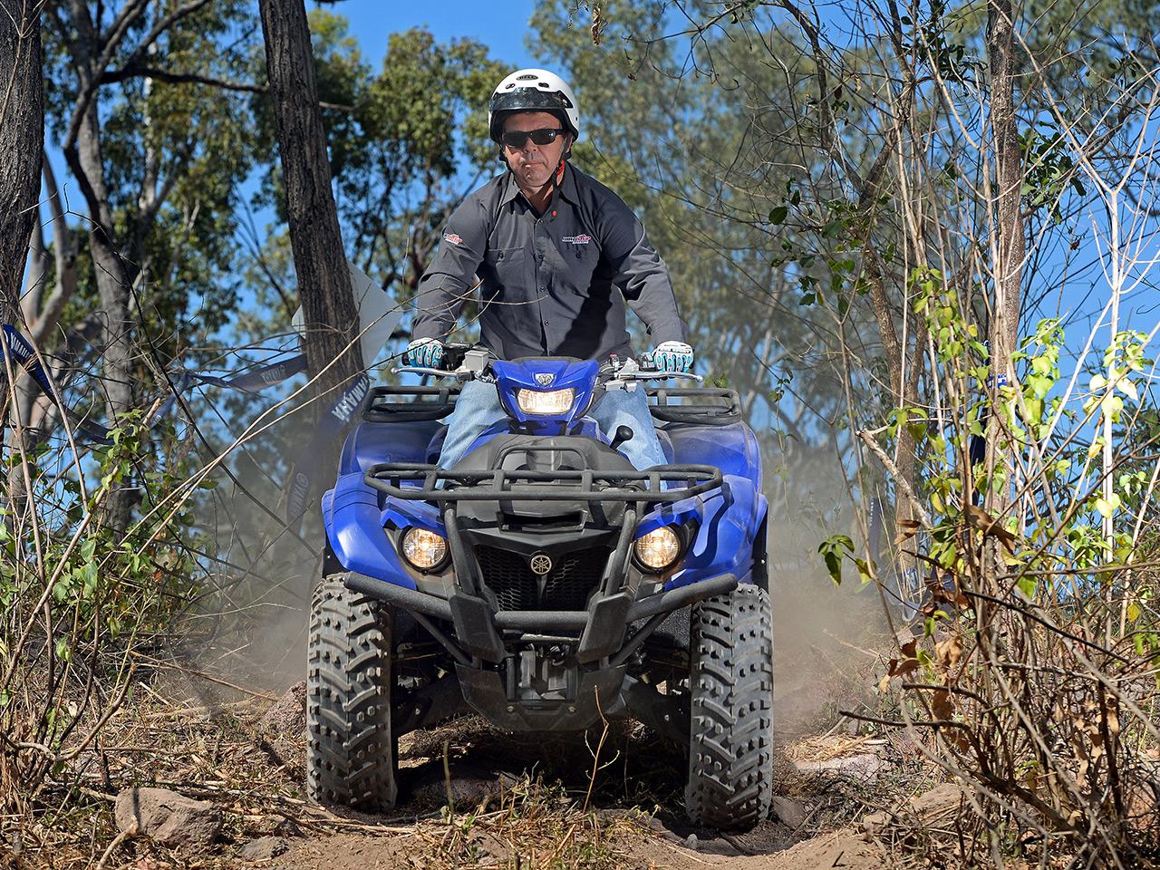 Yamaha Kodiak 700 EPS being ridden in a forest