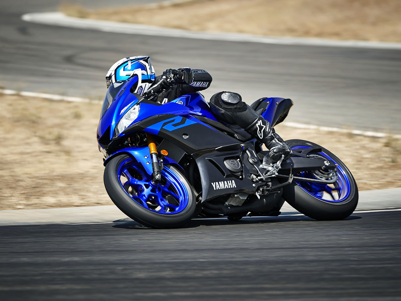 Yamaha YZF-R3 motorcycle riding on the road