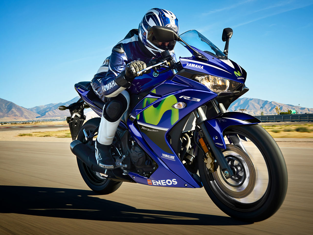Yamaha YZF-R3SP Movistar motorcycle riding on the road