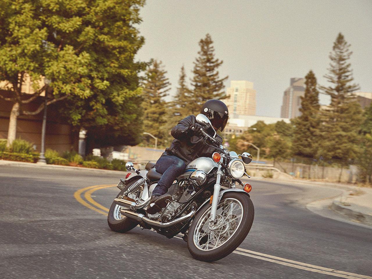 Yamaha XV250 motorcycle riding on the road