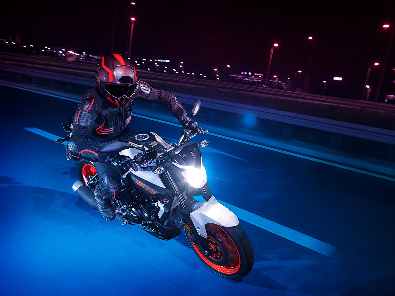 Yamaha MT-03 2019 in Ice Fluo colour, being ridden on a road
