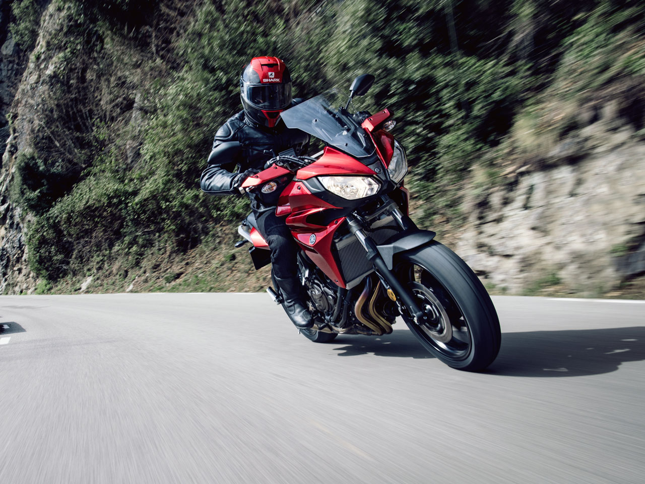 Yamaha Tracer 700 motorcycle riding on the hill road