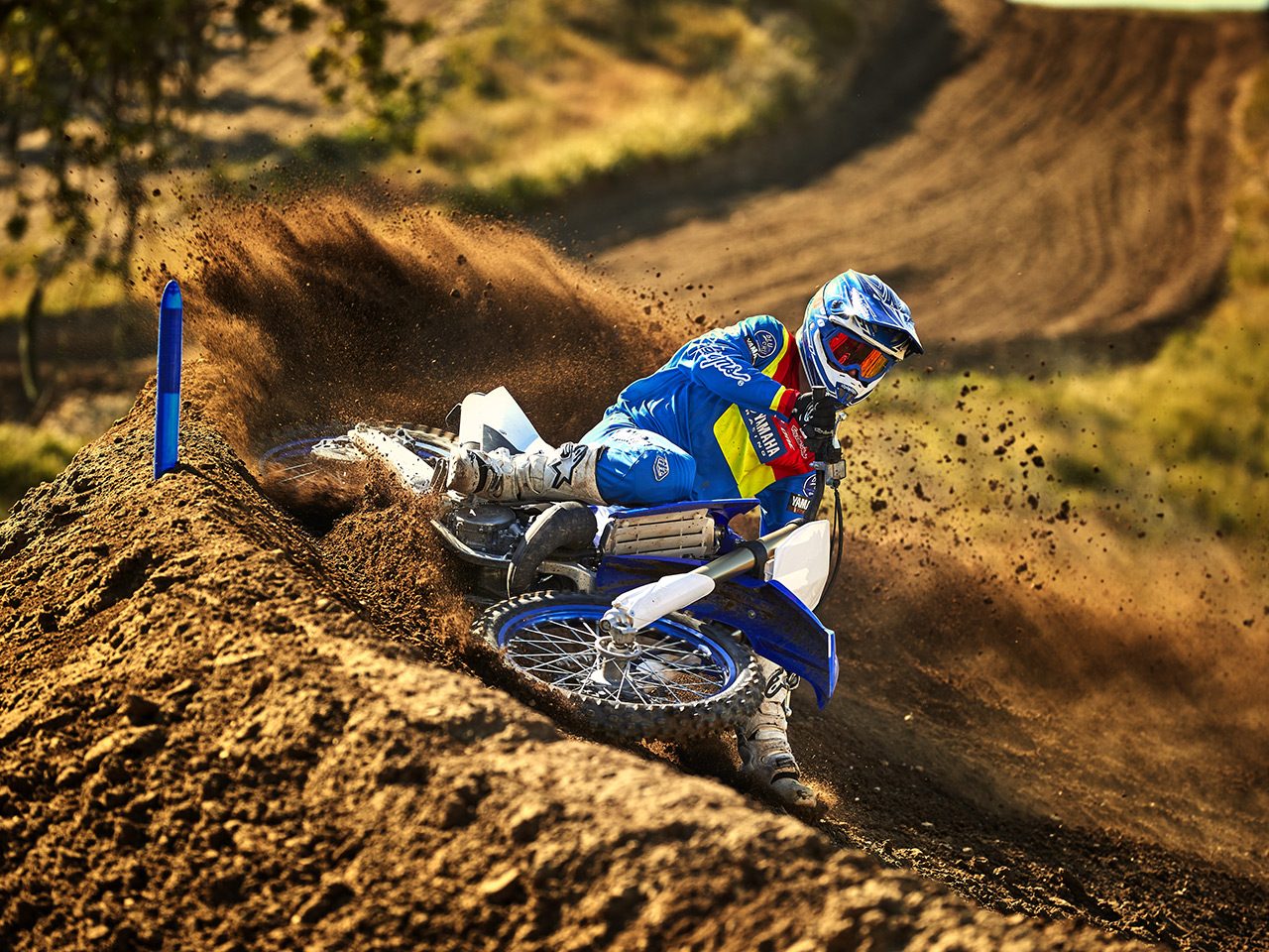 Yamaha YZ125 in team yamaha blue and white colour, being ridden off-track