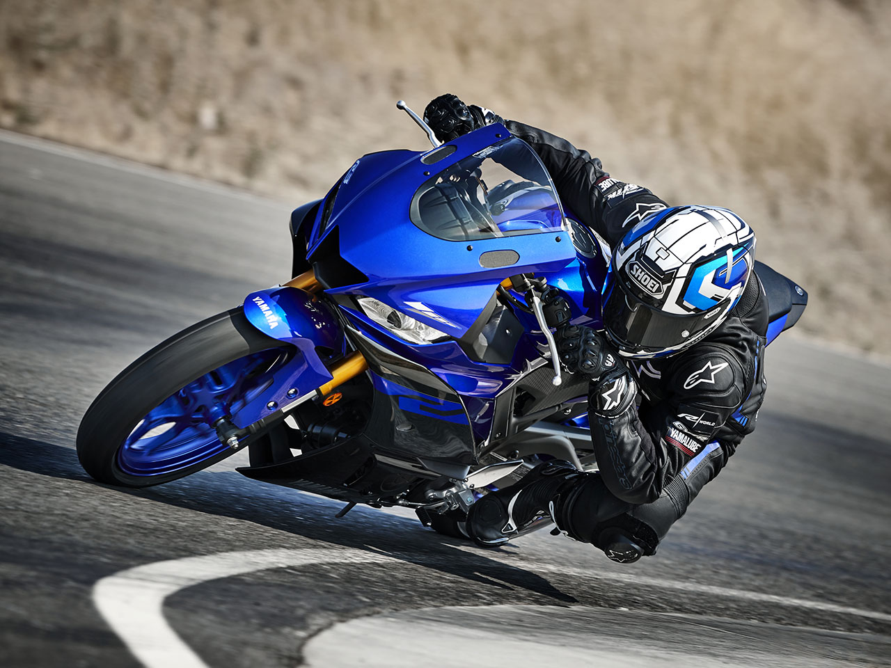 Yamaha YZF-R3 in yamaha blu colour being ridden on road