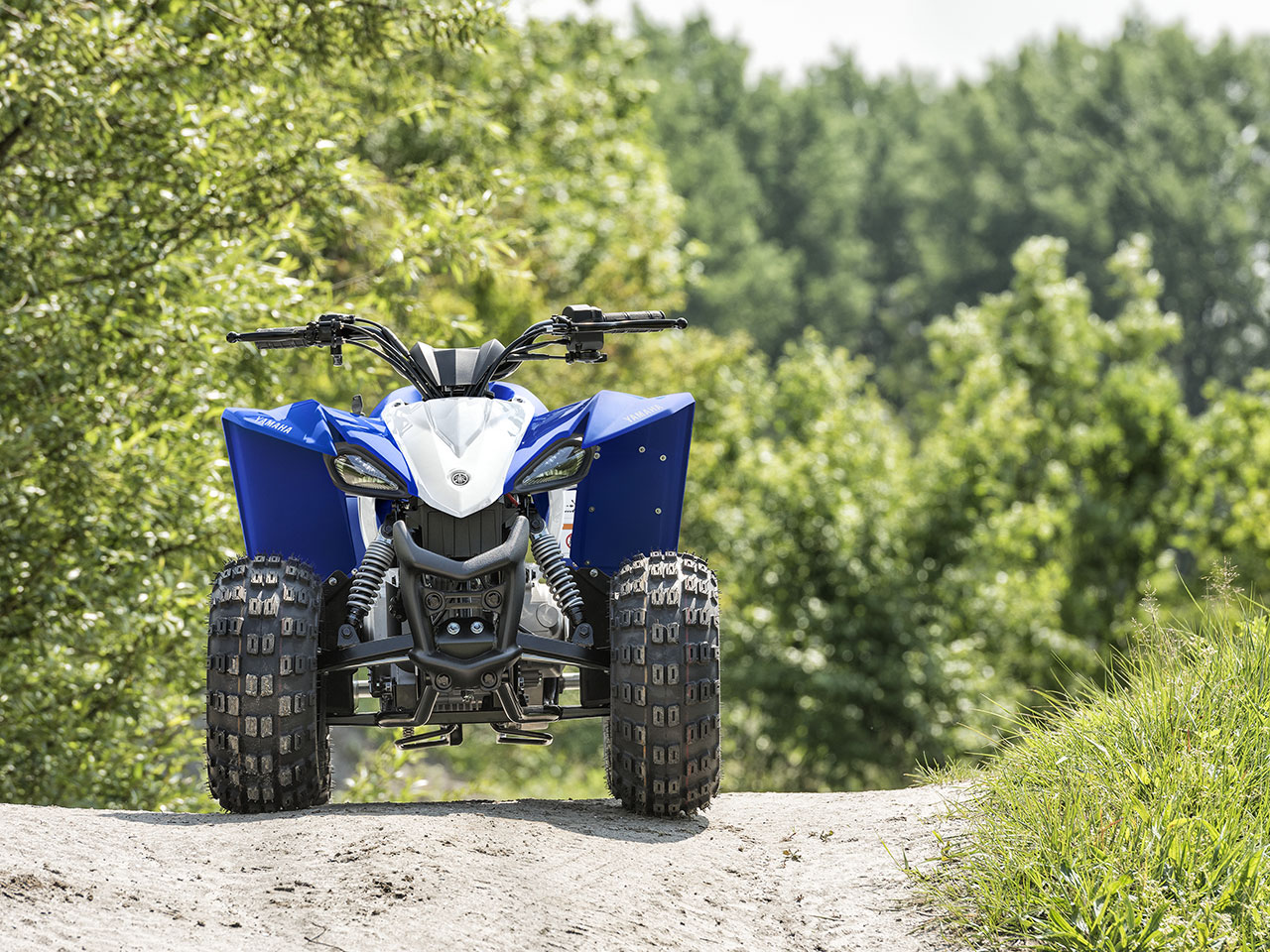 Yamaha YFZ50 in team yamaha blue and white colour, being ridden off-track